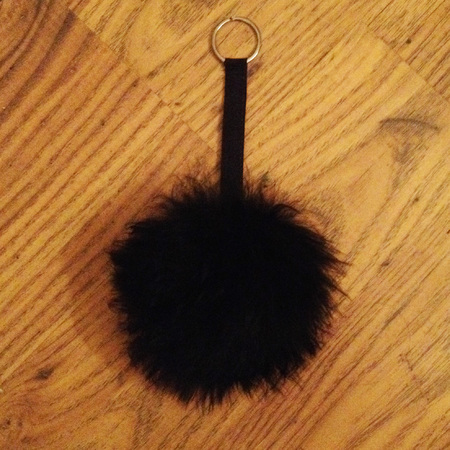 how to make your own pom pom handbag charm - final product - handbag.com