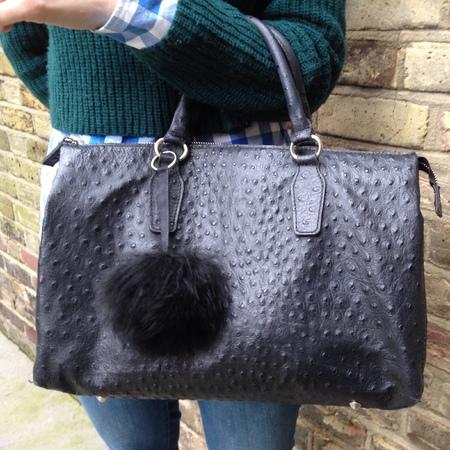 how to make your own pom pom handbag charm - finished product - street style - handbag.com