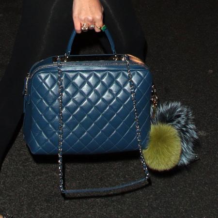 Lily Allens quilted chanel handbag - fendi pom poms - handbag trend - handbag.com
