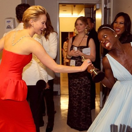 jennifer lawrence - lupita nyongo - best supporting actress at the oscars 2014 - fighting over award - handbag.com