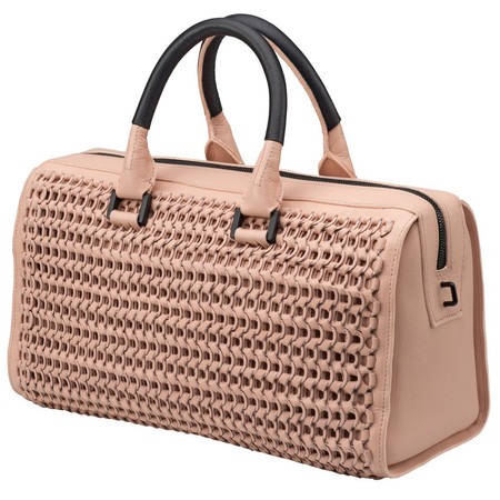 candice swanepoel victorias secret cream handbag - bottle top bag designed by narcisco rodriguez - charity ethical handbags - handbag.com