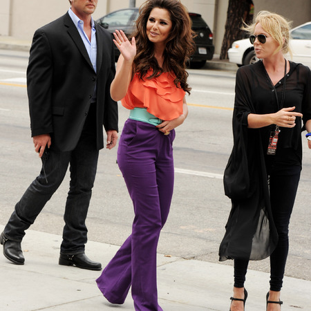 cheryl cole x factor usa - orange top and purple trousers - celebrity fashion fail - handbag.com
