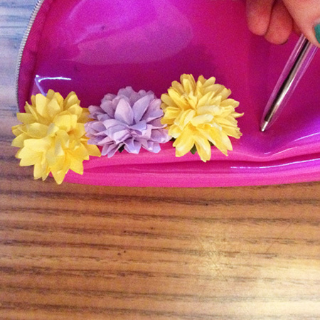 DIY Fashion Fix - how to make a Burberry style flower clutch bag - expand hole with pen - pic 4 - handbag.com