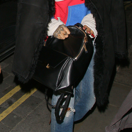 Rihanna - stella mccartney - black leather backpack - with drake - london - handbag.com