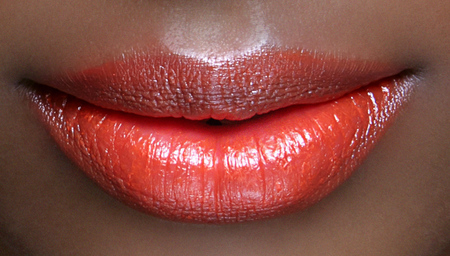orange lipstick trend - spring summer 2014 makeup beauty trends - new lipstick - black model - dkny fashion week - handbag.com