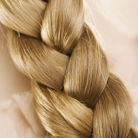 plait hairstyle - blonde hair plait close up - handbag.com