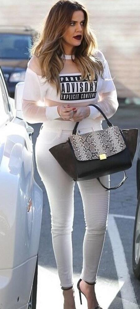 Khloe Kardashian and her Celine lizard skin trapeze bag