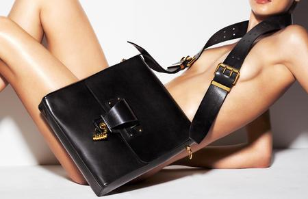 Tom Ford handbag e-commerce site - naked women selling handbags - Tom Ford bag collection - designer handbags - black leather bag - shopping news - handbag.com