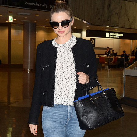 miranda kerr saint laurent handbag jeans and red shoes - celebrity airport style - miranda kerr fashion - handbag.com