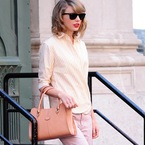 Taylor Swift gives us nude handbag envy