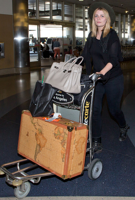 mischa barton map suitcase - alviero martini luggage - travel print bag - celebrity airport style - holiday fashion - handbag.com