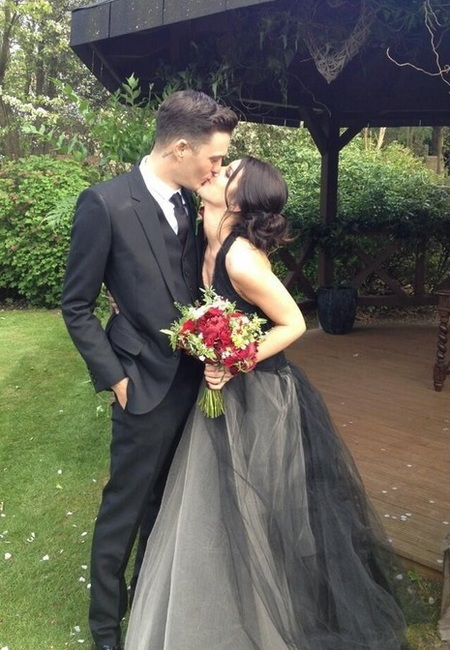 Shanae Grimes wears black Vera Wang wedding dress