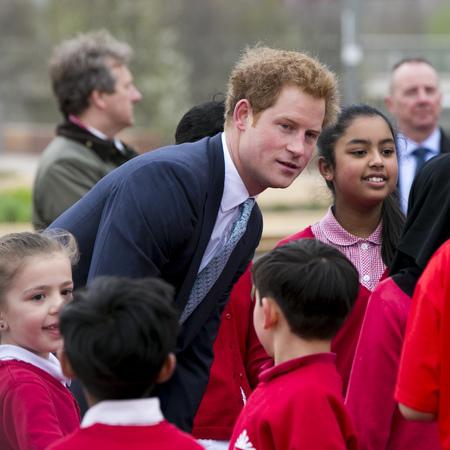 5 reasons prince harry would make a great boyfriend - prince harry chatting to schoolchildren - day bag - handbag