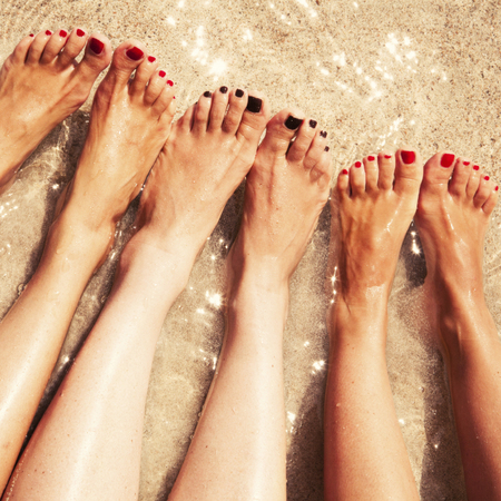 get your feet ready for summer-holiday-beach body-toe nails-cracked heels-women on holiday-woman foot-sand-sea-handbag.com