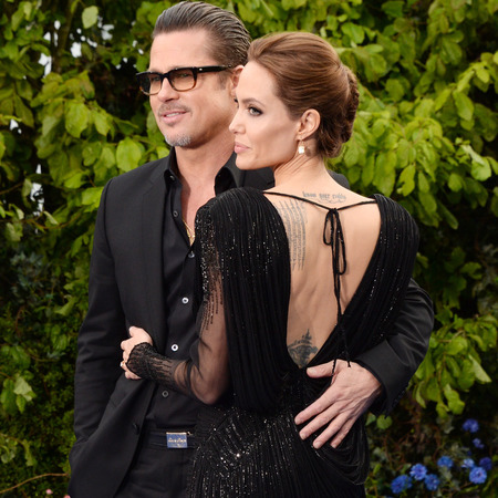angelina jolie-brad pitt-maleficent premiere-backless black dress-long sleeves-jack nicholson sunglasses-celebrity tattoos-handbag.com