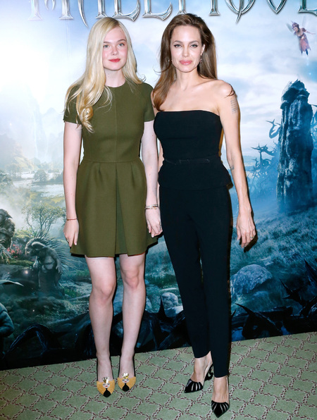 elle fanning and angelina jolie at maleficent photocall - angelina jolie and elle fanning accessorise their shoes to their film - shopping bag - handbag