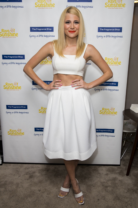 Pixie Lott - ray of sunshine concert - all white - crop top and knee length skirt - handbag.com