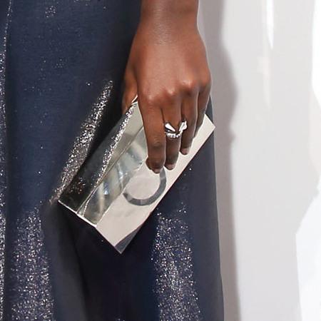 Lupita Nyong'o's metallic Calvin Klein clutch