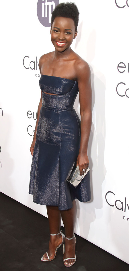 lupita nyongo-cannes film festival 2014-navy-blue-calvin klein-dress-slashed dress-silver sandals-metallic clutch bag-celebrity fashion-handbag.com