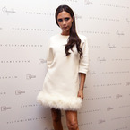 Victoria Beckham in feather dress. Pulling. It. Off.
