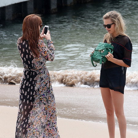 Cara Delevinge - handbag selfie - mulberry bag - posing for photo - handbag.com