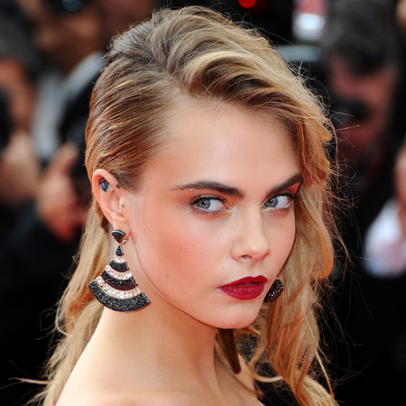 Cara Delevingne at Cannes 2014 red carpet - mini dress and chanel handbag - 80s makeup - celebs at Cannes - celebrity fashion - shopping bag - handbag.com