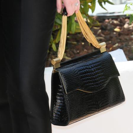 Christina Hendrick's Thalé Blanc black crocodile designer handbag