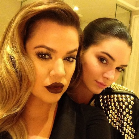 khloe kardashian-gothic glamour beauty trend-dark purple berry lipstick-paris-kim and kanye west wedding-blonde hair-kendall jenner-handbag.com