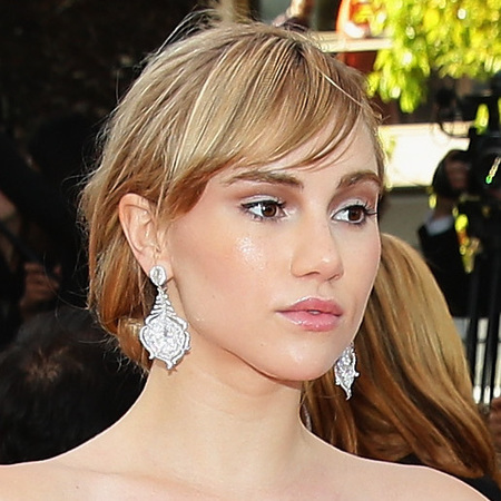suki waterhouse-cannes film festival 2014-red carpet-pink dress-two tier gown-strapless dress-fringe hairstyle-handbag.com