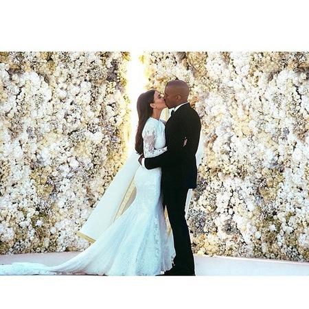 Kim and Kanye kissing at the altar