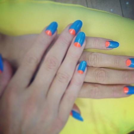 Laura Whitmore's blue and orange nail art