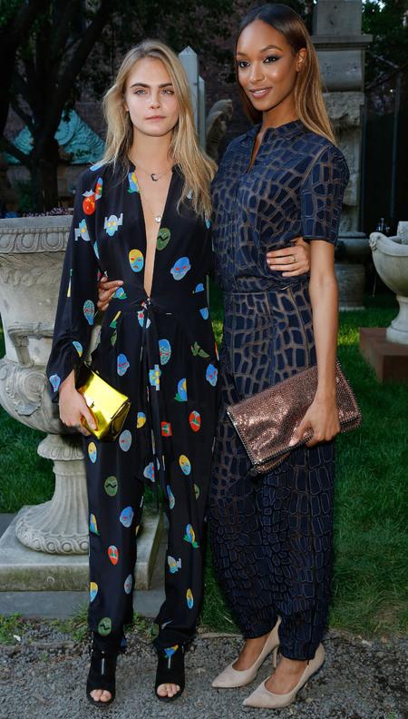 cara delevingne and jourdan dunn-stella mccartney resort pre spring 2015 garden party-superhero prints-jumpsuit trend-handbag.com