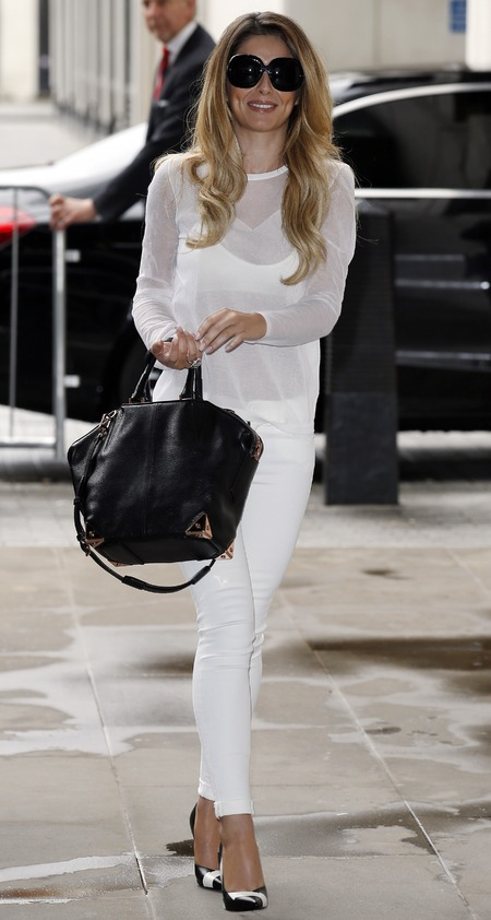 cheryl cole-all white outfit-trousers and mesh top-black handbag-blonde hair-new single-celebrity fashion trends-handbag.com