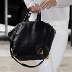 Cheryl Cole celebrates with a new Wang bag