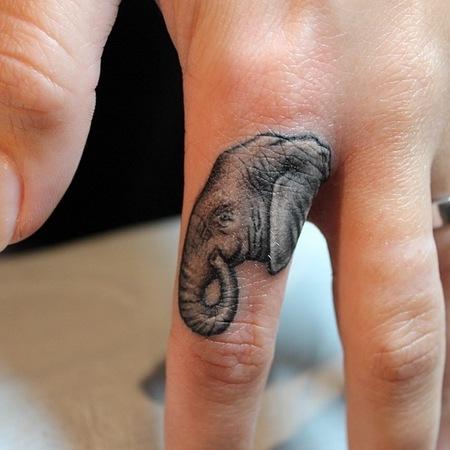 Cara Delevingne starts finger tattoo trend - elephant tattoo - new tattoo trend - fashion news - day bag - handbag.com
