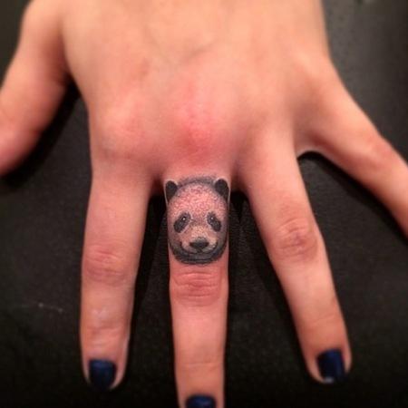 Cara Delevingne starts finger tattoo trend - unicorn tattoo - new tattoo trend - fashion news - day bag - handbag.com