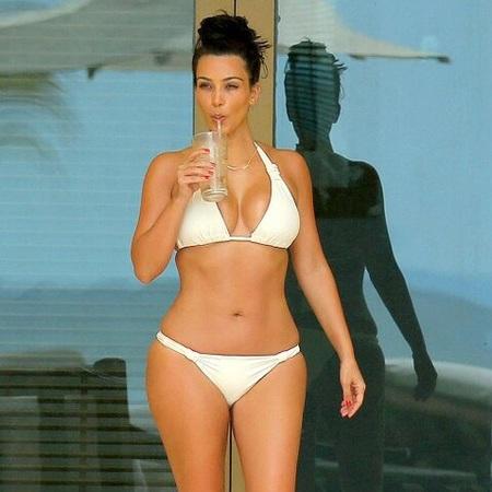 kim kardashian on honeymoon - twitter pic - bikini body - best bikini body - feature Kim Kardashian - diet - celeb - gym feature - gym bag - handbag.com