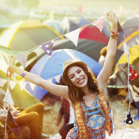Girl having fun at a music festival - summer festivals - summer festival fashion - summer events - what to do at a festival - day bag - handbag.com