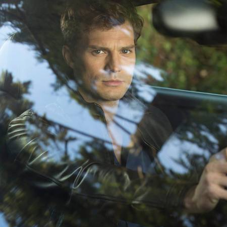 jamie dornan as christian grey driving a car - fifty shades of grey first image released - day bag - handbag
