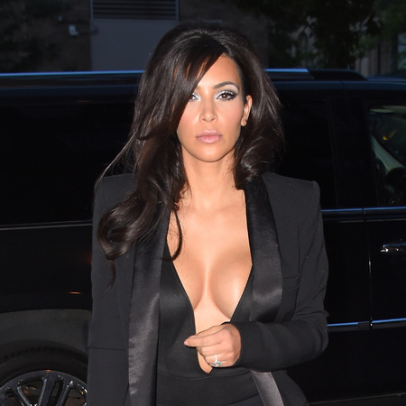 Kim Kardashian - boobs - cleavage - black tuxedo suit - handbag.com