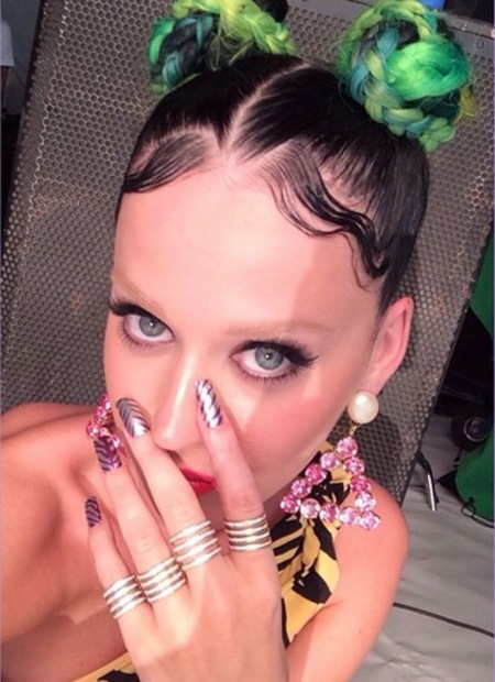 Katy perry - bleached eyebrows - bun hair style - green and black hair - handbag.com