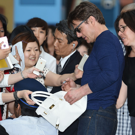 Tom Cruise - autograph signing - birkin bag - would you let a celebrity sign your handbag - handbag.com