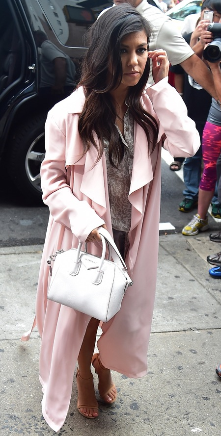 kourtney kardashian-white givenchy bag-mini handbag trend-long pink coat-khloe kardashian 30th birthday-handbag.com