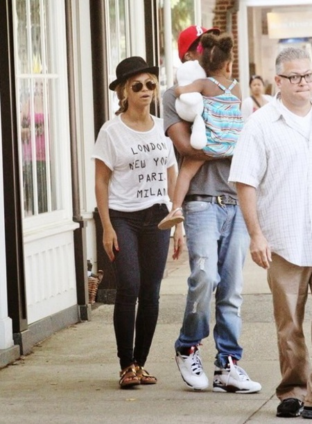 Beyonce with gold sliders in the Hamptons- get glam slider sandals - like beyonce from high street - shopping feature - handbag.com