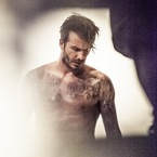 First look! David Beckham strips for H&M again