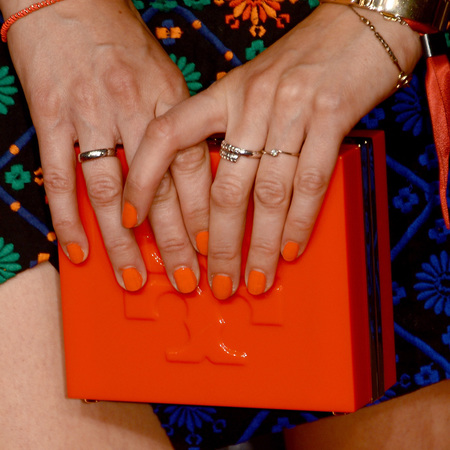 Eva Padberg's orange clutch bag