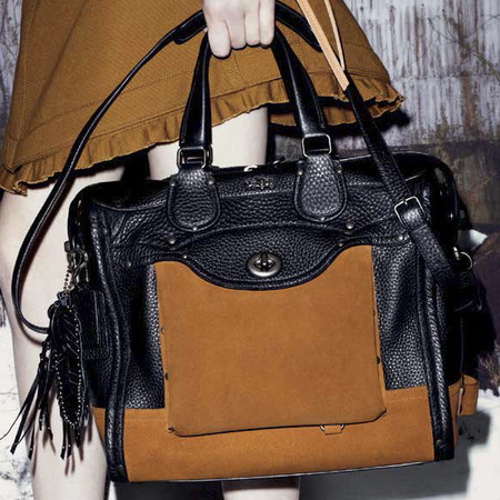 new coach handbags-stuart vevers debut collection-autumn winter 2014-ad campaign-brown and black leather handbag-handbag.com