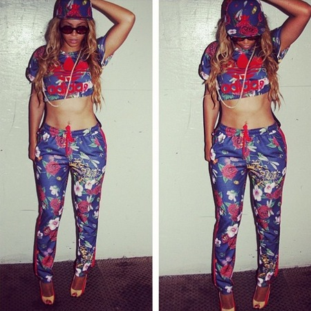 Beyonce wearing the Rose Collection tracksuit and crop top